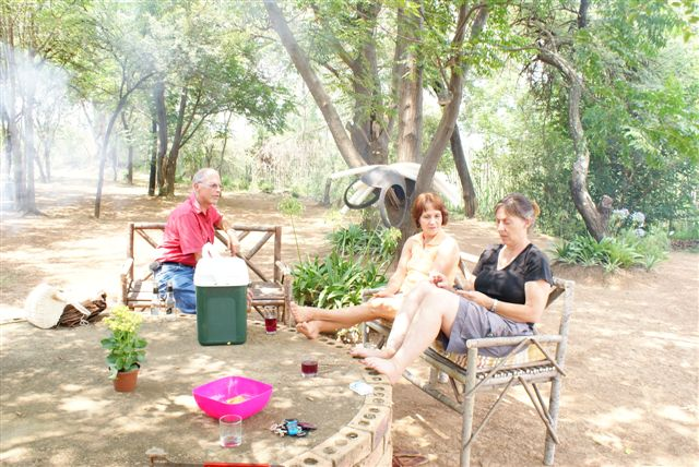 Enjoy a braai under the shade of the trees when you stay at The Farm House Hartebeestfontein self catering accommodation
